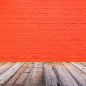 Room interior with red brick wall background — Stock Photo