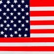 American flag painted on fence background. — Stock Photo