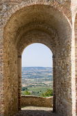 Landscape through an arch — Stock Photo