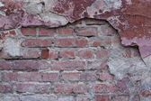 Background old brick wall with plaster — Stock Photo