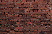 Old red brick wall for background — Stock Photo