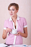 Woman manager in office with cup tea — Stock Photo