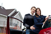 Young successful family near the car — Stock Photo