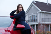 Beautiful girl near the car — Stock Photo