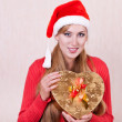 Royalty-Free Stock Photo: Young smiling woman in Santa Claus hat