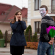 Stock Photo: Hacker in masked and frightened woman