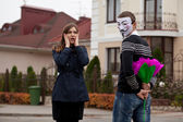 Hacker in masked and frightened woman — Stock Photo