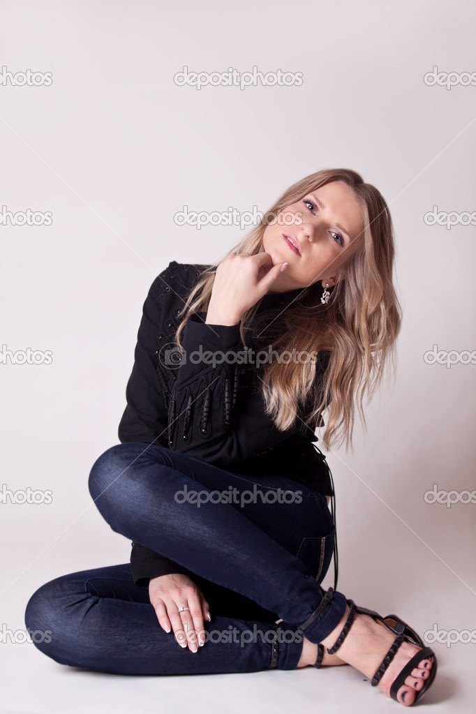 Woman sit and looking at camera. studio shot — Stock Photo #14793437