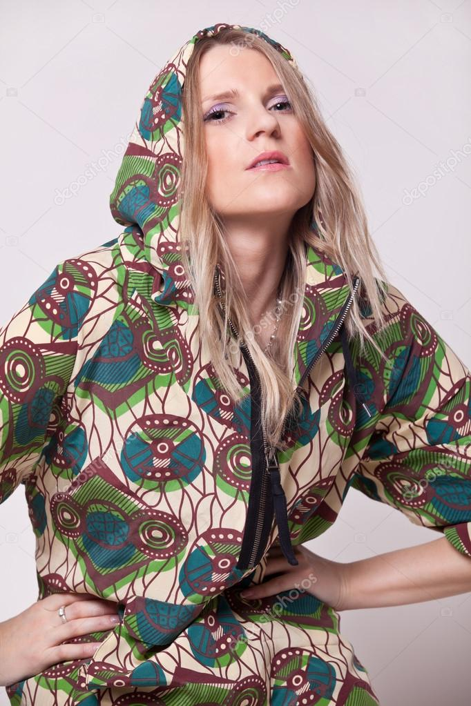 Woman posing in bright clothing with hood on his head — Stock Photo #14794273