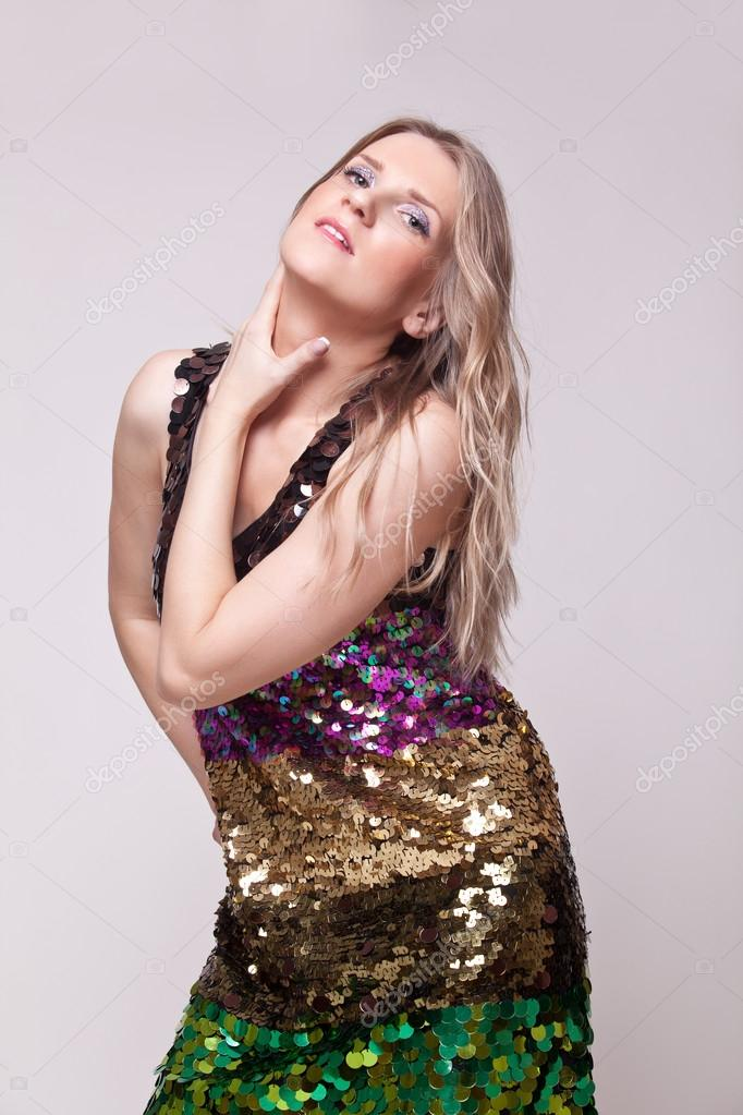 Elegant blonde in bright dress posing in studio  — Stock Photo #14794819