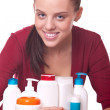 Young woman near set of cosmetics for skincare — Stock Photo