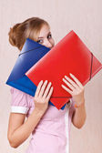 Businesswoman covered his face folders — Stock Photo