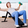 Young woman training for muscle of chest — Stock Photo