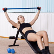 Stock Photo: Womtraining with dumbbells