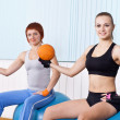 Two fitness woman do exercises — Stock Photo