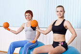 Two fitness woman do exercises — Stockfoto