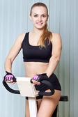 Woman doing exercise on training apparatus — Stock Photo