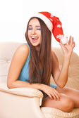 Enthusiastic girl in christmas hat — Stock Photo