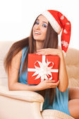 Beautiful girl in christmas hat — Stock Photo