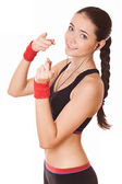 Sporty woman shows towards you — Stock Photo