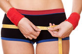 Closeup woman measuring hips 90 centimeters — Stock Photo
