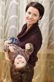 Mother holding baby in arms — Stock Photo