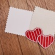 Foto Stock: Two empty papers with red hearts