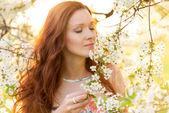 Pretty woman in garden — Stock Photo