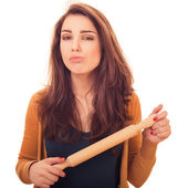Woman holds rolling-pin — Stock Photo