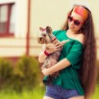 Stock Photo: Teenager with dog yorkshire terrier on hands