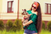 Teenager with dog yorkshire terrier on hands — Stock Photo