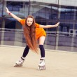 Stock Photo: Womon rollerblading in city on sunny day