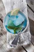Bowl of colored ice-cubes  — Stock Photo
