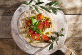 Raw pizza with tomato and olives  — Stockfoto