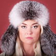 Blond girl in a fur hat — Stock Photo