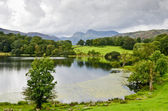 Loughrigg Tarn and the Langdale Pikes — Stock Photo