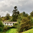 Whitewashed Lakeland Cottage on a Hillside — Stock Photo