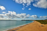 South Beach Tenby, with Caldey island. — Stock Photo
