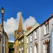 St Mary's Church, Tenby,viewed from a picturesque street. - Stock Photo