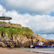 Stock Photo: View of boat and bandstand at Castle Beach, Tenby.