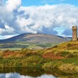 Old lighthouse and Black Combe near Millom. — Stock Photo