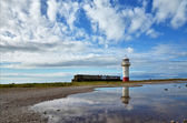 Lighthouse on the shoreline at Millom, Cumbria. — Stock Photo