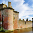 Caerlaverock Castle and moat. - Stock Photo