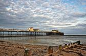 Worthing pier and shingle beach — Stock Photo