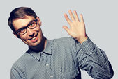 Funny young man wearing glasses say Hello — Stock Photo