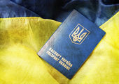 Blue yellow flag and passport of Ukraine — Stock Photo
