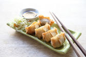 Wonton on wood blackground — Stockfoto
