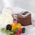 Chocolate Lava Cake with ice cream and fruit — Stock Photo