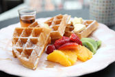 Waffle with fruits — Stock Photo