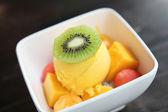 Scoops of mango ice cream fruit — Stock Photo